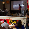 Event preparations. Seth Samuel and Molly Samuel on stage; Erica Mu, right; Wendy Baker, computer. KALW Mission Arts and Performance Project (MAPP) June 2012, The Polish Club, 3040-22nd St. at Shotwell St., Mission district, San Francisco, California.