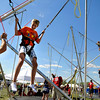 Sean Aruabarrena, 16, of Fort Collins, at left, helps down Xander Spitzer, 11, of Centennial, after jumping around on the bungees during the Heaven Festival on Saturday, July 31, at the Union Reservoir in Longmont. <br /> Jeremy Papasso/ Camera
