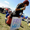 Angelo Subia, 12, of Arvada, holds his free hugs sign during the Heaven Festival on Saturday, July 31, at the Union Reservoir in Longmont. <br /> Jeremy Papasso/ Camera