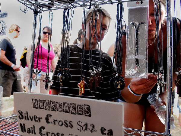 "John Ferrara, 8, at left, and his mother Nicole Ferrara, 29, of Brighton, look to purchase a cross necklace from a vendor during the Heaven Festival on Saturday, July 31, at the Union Reservoir in Longmont.<br /> Jeremy Papasso/ Camera<br /> <br /> <br /> For photo gallery and video go to  <a href=""http://www.dailycamera.com"">http://www.dailycamera.com</a>"