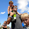 Jadon, 3, sits on his father Matthew Russell's shoulders while his older brother Triston, at right, listens to the music during the Heaven Festival on Saturday, July 31, at the Union Reservoir in Longmont. <br /> Jeremy Papasso/ Camera