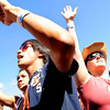 Erica Anderson, 16, of Lakewood, at left, Daren Casey, 19, of Lakewood, and Shandra Weese, 34, of Lakewood, raise their hands up towards the sky during a band performance at the Heaven Festival on Saturday, July 31, at the Union Reservoir in Longmont. <br /> Jeremy Papasso/ Camera