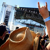 Shandra Weese, 34, of Lakewood, at front, raises her hand with excitement while watching a band perform during the Heaven Festival on Saturday, July 31, at the Union Reservoir in Longmont. <br /> Jeremy Papasso/ Camera
