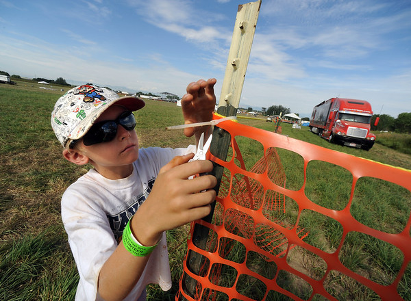 "Asher Miles, 8, was helping his mother take down some of the fencing at Heaven Fest.<br /> Staff and volunteers spent Sunday taking down stages and tents, and generally cleaning up the site of Heaven Fest, the one-day Christian music festival held at Union Reservoir near Longmont.<br /> For more photos  of the clean up, go to  <a href=""http://www.dailycamera.com"">http://www.dailycamera.com</a><br />  Cliff Grassmick / August 1, 2010"