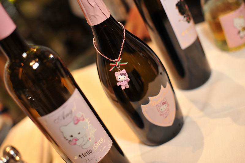 """Hello Kitty, she is a Japanese cartoon cat invented by the design company Sanrio in 1974. She was created without a mouth because she speaks from the heart so no one language is necessary. From the famous Lombardi region in Italy, Hello Kitty offers 4 distinct DOC certified (Vino a Demoninazione di Origine Controllata) wines. That means these wines are grown in a specific region with very specific rules of production they must follow. Try the  Hello Kitty Angel White made from Pinot Noir free run juice or the  Hello Kitty Devil Red that's garnet red in color with a wild flowers bouquet. You might also like the Hello Kitty Sparkling Brut Rose with its deep red pink hue and rose petal nose or the semi-sweet sparkler with delicate bubbles known as the Hello Kitty Sparkling """"Sweet Pink."""" Photograph by Las Vegas photographer Mark Bowers."""