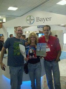 Vaughn Ripley, Laurie Kelley and Barry Haarde: Vaughn and Barry showing off articles about themselves--whose is longer?