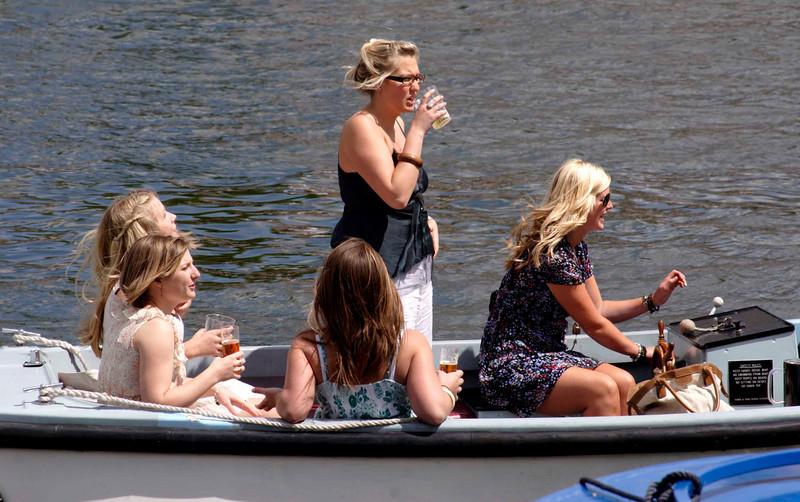 Spectators in a boat at Henley regatta July 2008
