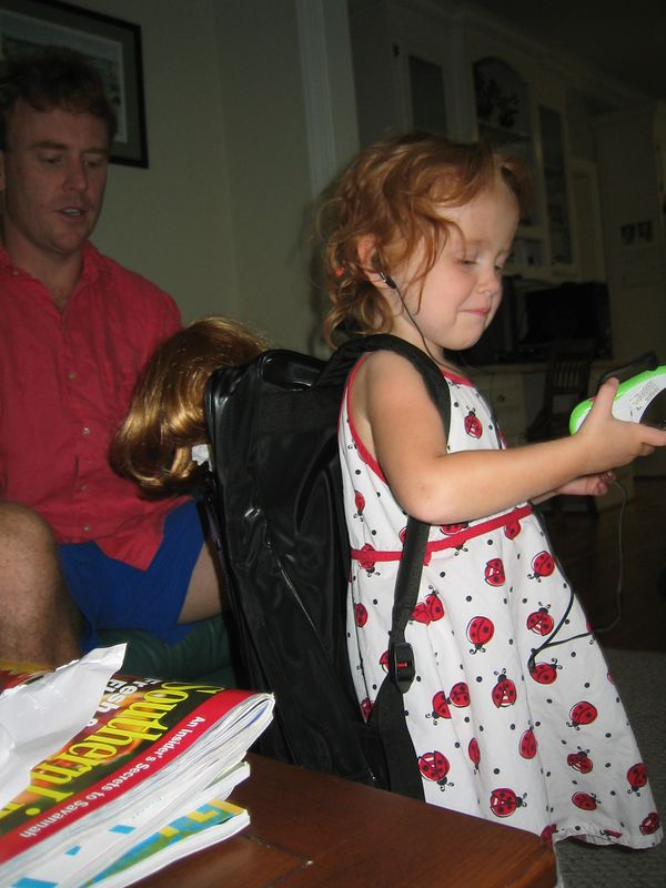 Elizabeth testing out her new backpack to hold her American Girl doll and her new radio.  Gram and Papa gave her those presents.