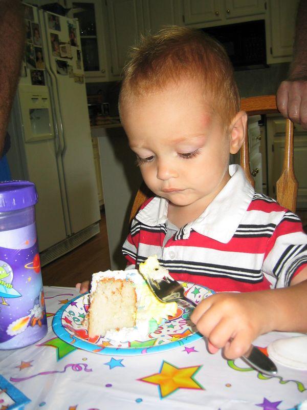 Here is the birthday boy eating cake!  Happy 2nd Birthday Henry!