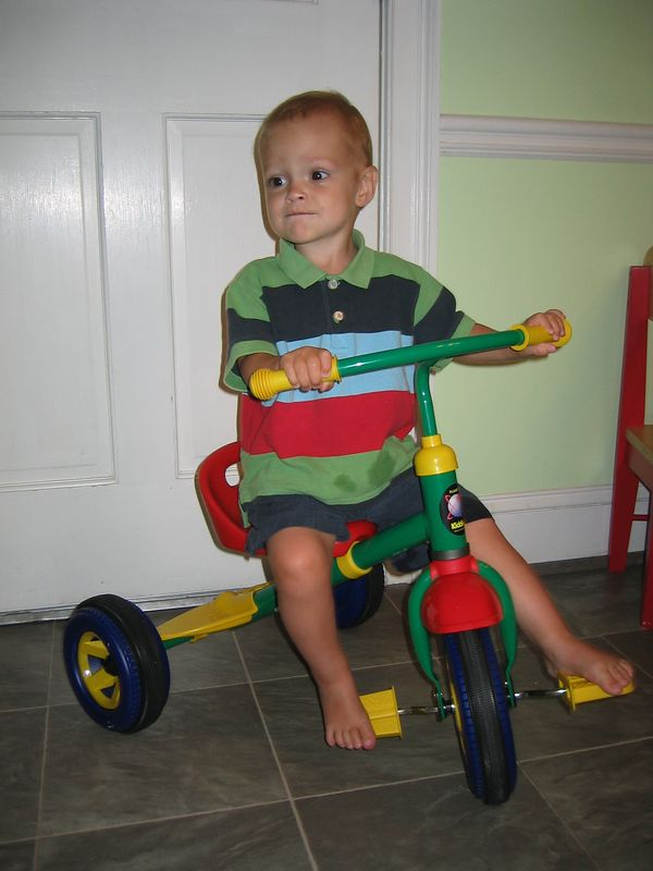 Henry got this new tricycle from his Great-Grandmother and Great-Grandfather.  He had so much fun riding on it!