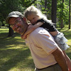 County Commissioner Ricky Gamble Jr. gives his daughter a piggy back ride.