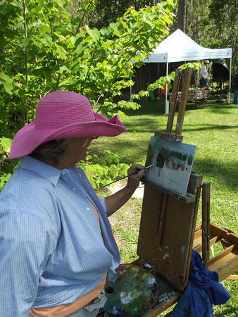 Cathy Willson paints a portrait of the grounds and mansion.