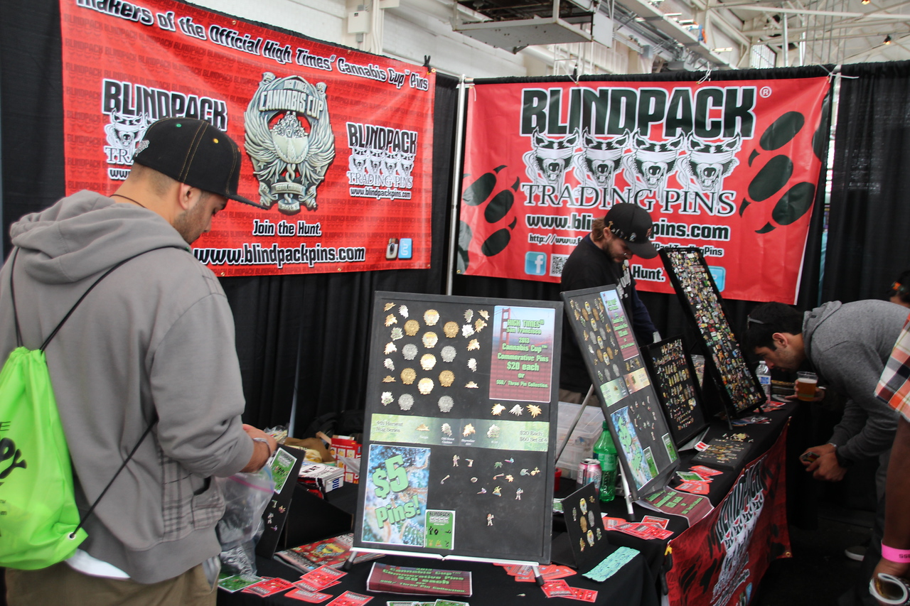 A sales booth offering decorative pins - also sold at www.blindpackpins.com