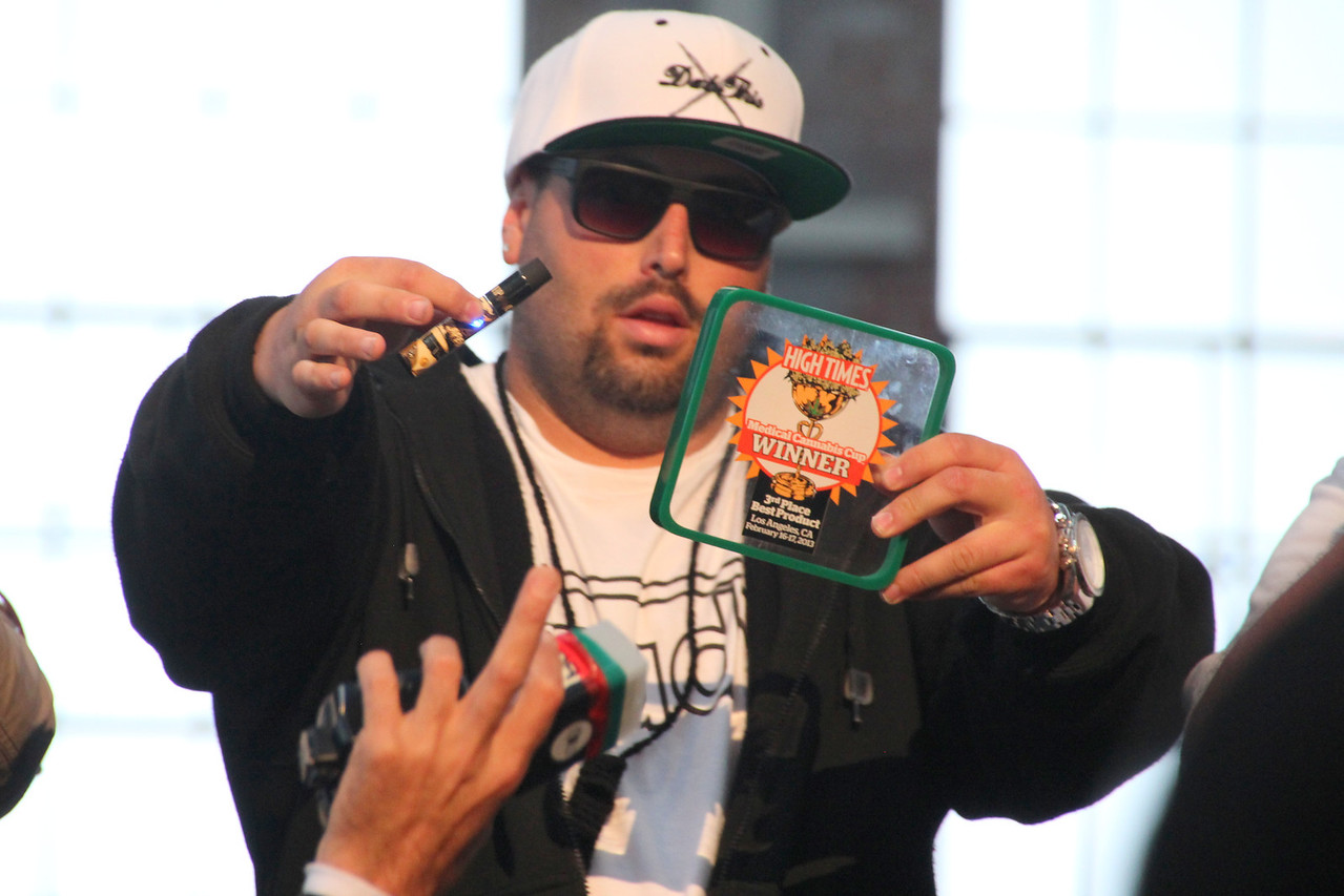 A winner showing off his award from a prior win - 3rd Place Best Product in the February 16-17th, 2013 Cannabis Cup in Los Angeles.