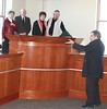 Chadron State College Vice President for AdministrationDale Grant, at right, shows off the new mock courtroom in the Administration building. Taking part in the tour, that was in late December, are Delbert and Aleta Hussey of Chadron and Jerry and Barbara Tallman of Mitchell. (Photo by Con Marshall)