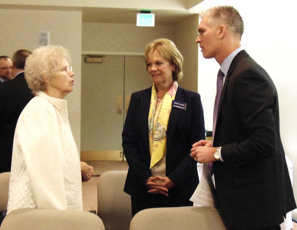 Diane Raver | The Herald-Tribune<br /> Shareholder Kay Koppel (from left), Osgood, talks with board members Helen Cornell and Joe Raver after the meeting.