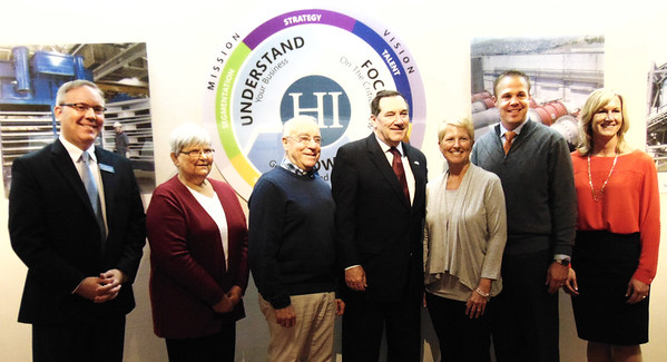 Diane Raver | The Herald-Tribune<br /> Sen. Joe Donnelly (center) greets Batesville Community School Corp. superintendent Paul Ketcham (from left), trustees Wanita Linkel, Dr. Stephen Stein and Cindy Blessing, BCSC board President Jeremy Raver and director of student learning Melissa Burton.