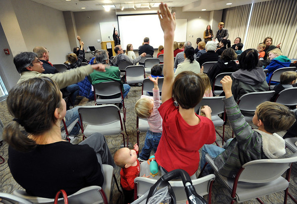 """Kate Funsch, left, and baby, Ana Ferara, listen to questions while Claire Ferara, Cole Lewis, and Carter Ferara, raise their hands to answer questions about Hobbits.<br /> The Grey Havens Group celebrated a Hobbit Holiday at the  Longmont Public Library on Sunday with readings, games and activities.<br /> For a video and more photos of the Hobbit Holiday, go to  <a href=""""http://www.timescall.com"""">http://www.timescall.com</a>.<br /> Cliff Grassmick  / December 9, 2012"""