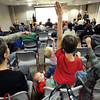 "Kate Funsch, left, and baby, Ana Ferara, listen to questions while Claire Ferara, Cole Lewis, and Carter Ferara, raise their hands to answer questions about Hobbits.<br /> The Grey Havens Group celebrated a Hobbit Holiday at the  Longmont Public Library on Sunday with readings, games and activities.<br /> For a video and more photos of the Hobbit Holiday, go to  <a href=""http://www.timescall.com"">http://www.timescall.com</a>.<br /> Cliff Grassmick  / December 9, 2012"
