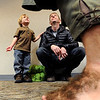 """Eli Billiings, 4, and his father, Stephen, listen to Bilbo Baggins (Clay Evans) as seen through Baggins' hairy feet.<br /> The Grey Havens Group celebrated a Hobbit Holiday at the  Longmont Public Library on Sunday with readings, games and activities.<br /> For a video of the Hobbit Holiday, go to  <a href=""""http://www.timescall.com"""">http://www.timescall.com</a>.<br /> Cliff Grassmick  / December 9, 2012"""