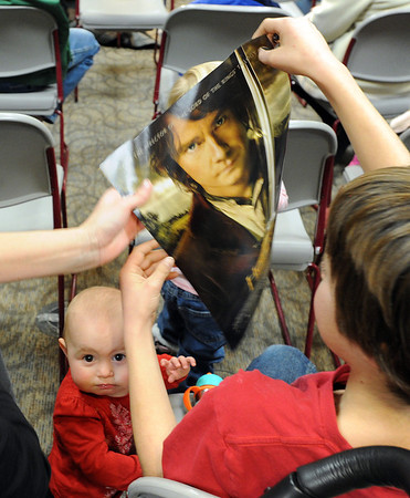 """Ana Ferara, 1, might be wondering what all the excitement is about when discussing Hobbits.<br /> The Grey Havens Group celebrated a Hobbit Holiday at the  Longmont Public Library on Sunday with readings, games and activities.<br /> For a video of the Hobbit Holiday, go to  <a href=""""http://www.timescall.com"""">http://www.timescall.com</a>.<br /> Cliff Grassmick  / December 9, 2012"""