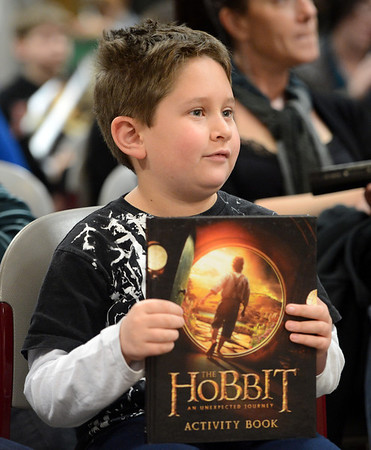 "Joshua Freese, 9, won a book for his knowledge of Hobbits.<br /> The Grey Havens Group celebrated a Hobbit Holiday at the  Longmont Public Library on Sunday with readings, games and activities.<br /> For a video and photos of the Hobbit Holiday, go to  <a href=""http://www.timescall.com"">http://www.timescall.com</a>.<br /> Cliff Grassmick  / December 9, 2012"