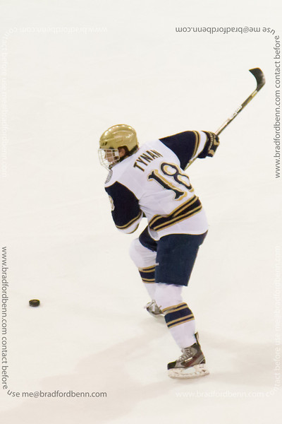 T.J. Tynan takes a slap shot.