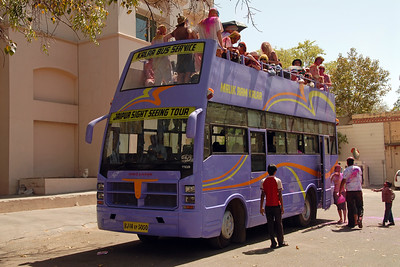 Tourists to Jaipur Pink City were taken free of cost for an hour long ride on an open top bus through the key locations of the city to see the celebrations.   Holi the Festival of Colours being celebrated in Khasa Kothi, Jaipur, the Capital city of Rajasthan, India.
