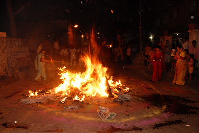 My Aunt Durgesh Aunty at the bonfire which is lit on the night before the Holi festival of colours. Women from the area come and pray and make offerings into the fire. Its custom to bring stalks of wheat, barley & other grains which are lightly roasted and then taken as prasad for a prosperous year ahead.  Holi the Festival of Colours being celebrated in Jaipur, the Capital city of Rajasthan, India.