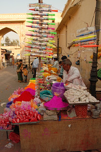 Colours being sold at the Shri Radhagovind Mandir in Jaipur where holi is well celebrated. Holi the Festival of Colours being celebrated in Jaipur, the Capital city of Rajasthan, India.