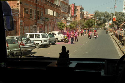 Tourists to Jaipur Pink City were taken free of cost for an hour long ride on an open top bus through the key locations of the city to see the celebrations.   Holi the Festival of Colours being celebrated in Jaipur, the Capital city of Rajasthan, India.