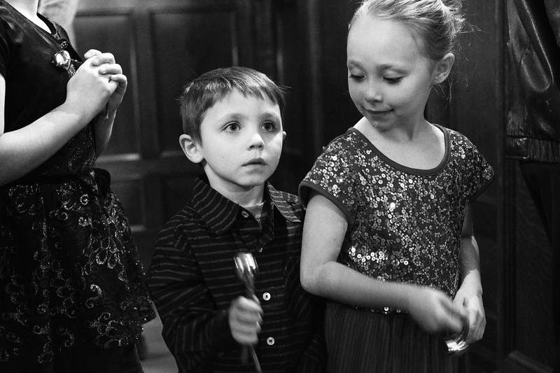 Justin Sheely | The Sheridan Press<br /> Five-year-old Ayden Davis, left, and Emily Davis, 7, ring their jingle bells to the music during the annual Holiday Open House Friday evening at the Trail End State Historic Site. The historic site commonly known as Kendrick Mansion is hosting open houses Saturday and Sunday, December 2 and 3 from 4 p.m. to 7 p.m. Events include live music, figgy pudding and a visit with Father Christmas.