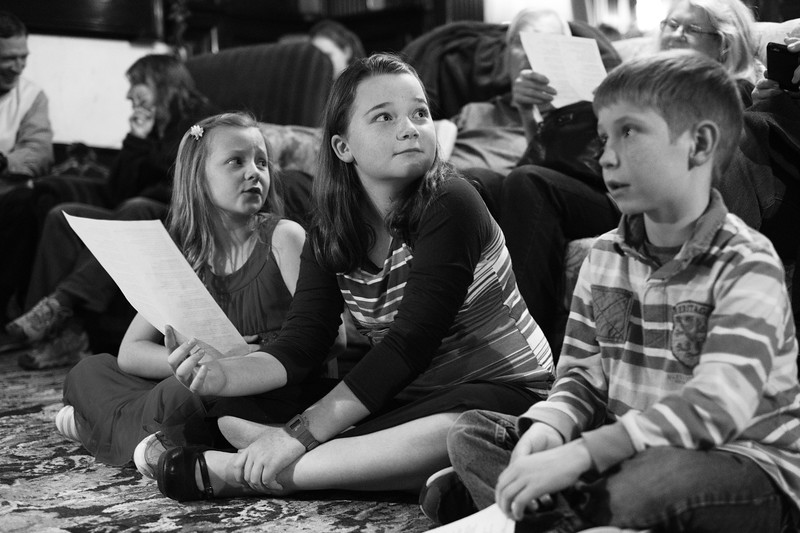 Justin Sheely | The Sheridan Press<br /> Nine-year-old Larissa Hoffmann, left, Erin Hoffmann, 11, and Jack Hubert sing Christmas carols during the annual Holiday Open House Friday evening at the Trail End State Historic Site. The historic site commonly known as Kendrick Mansion is hosting open houses Saturday and Sunday, December 2 and 3 from 4 p.m. to 7 p.m. Events include live music, figgy pudding and a visit with Father Christmas.