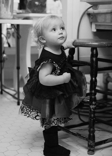 Justin Sheely | The Sheridan Press<br /> One-year-old Kyla Walter stand in the kitchen as guests are served during the annual Holiday Open House Friday evening at the Trail End State Historic Site. The historic site commonly known as Kendrick Mansion is hosting open houses Saturday and Sunday, December 2 and 3 from 4 p.m. to 7 p.m. Events include live music, figgy pudding and a visit with Father Christmas.