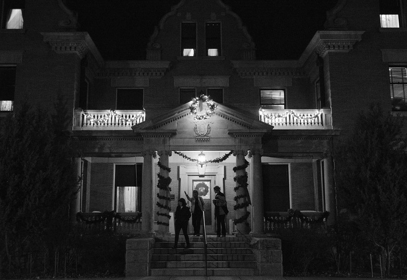 Justin Sheely | The Sheridan Press<br /> Guests leave the mansion during the annual Holiday Open House Friday evening at the Trail End State Historic Site. The historic site commonly known as Kendrick Mansion is hosting open houses Saturday and Sunday, December 2 and 3 from 4 p.m. to 7 p.m. Events include live music, figgy pudding and a visit with Father Christmas.