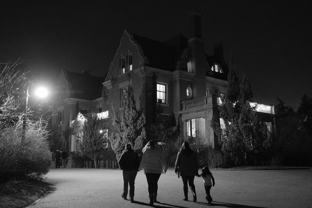 Justin Sheely | The Sheridan Press<br /> Guests approach the mansion during the annual Holiday Open House Friday evening at the Trail End State Historic Site. The historic site commonly known as Kendrick Mansion is hosting open houses Saturday and Sunday, December 2 and 3 from 4 p.m. to 7 p.m. Events include live music, figgy pudding and a visit with Father Christmas.