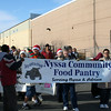 Mboyi and Aqsa carried the Nyssa Food Pantry Banner.