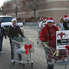 Sarah (in the white hat) pushed a shopping cart.