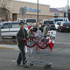Mahmoud pushed a shopping cart to collect food donations for the food bank.