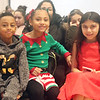 Holidays with Hope party sponsored by Hope Dove, Inc. at UTEC in Lowell. From left, Elijah Martinez, 7, and Sharleyne Fuentes, 8, both of New Bedford, and Juliana Irizarry, 11, of Nashua. (SUN/Julia Malakie)
