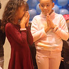 Holidays with Hope party sponsored by Hope Dove, Inc. at UTEC in Lowell. Shanelly Perez, left, and Channel Pena, both 8 and from Lowell, during opening prayer. (SUN/Julia Malakie)