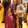 Holidays with Hope party sponsored by Hope Dove, Inc. at UTEC in Lowell. Ileana Soto of Lowell as Rapunzel, posing for a photo with Isabella Rivera, 9, of Lowell. (SUN/Julia Malakie)