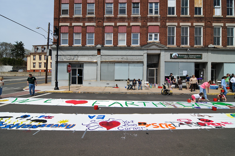 The banners were laid down on Park Place in front of the Rockville Downtown Association to provide easy access for all the painters.