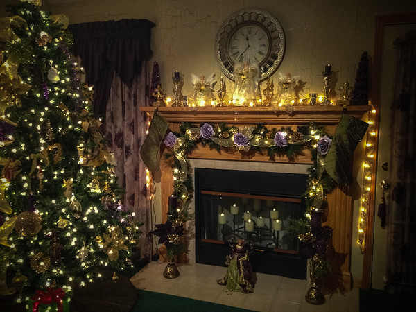 A picture of our Christmas Tree and decorated fireplace