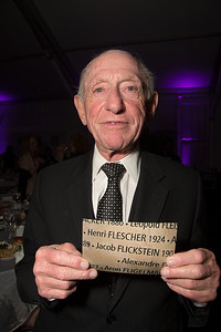 "Survivor Henry Flescher (89) was born in Vienna Austria and initially escaped to France where he was eventually interred in Drancy deportation camp, a place where Jews, Gypsies, and others were held before being shipped to the German concentration camps. On the matter of the Vichy French, Henry simply says ""Petain gave me to Eichmann""."