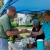 Kayla Rice/Reformer                                <br /> Allan Hansell buys lemonade from Holton Home residents, Mary Dauphinais (right) and Kay Champeoli (left) during their lemonade stand to benefit Holton Home's Team for the Brattleboro Walk to End Alzheimer's.