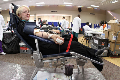 Kay Warthman stops by the Bob Buechner Blood Drive at her parish, Holy Cross Church, Dec. 11. Warthman, a nurse by profession, has been donating blood for 35 years.