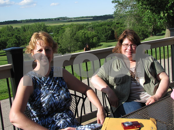Brenda McBride and Paula Griffin of D/SAOC enjoy the evening on the patio for the Ladies Event hosted by Active Health Chiropractic.