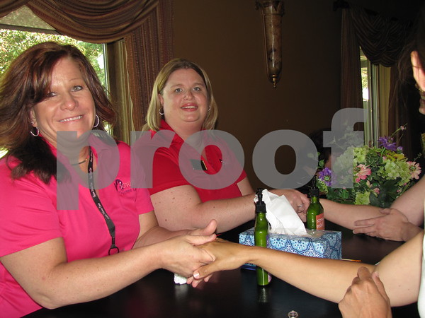 Tammy Hobmeir and Tanya Black of Iowa Home Care gave hand massages to attendees at the Ladies Event held at Willow Ridge.
