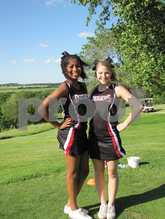 Dodge cheerleaders Meka Mosley and Taylor Hammersland oversaw the putting game right outside the clubhouse at Willow Ridge.